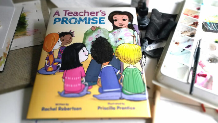 Teacher's Promise book sitting on desk with art supplies