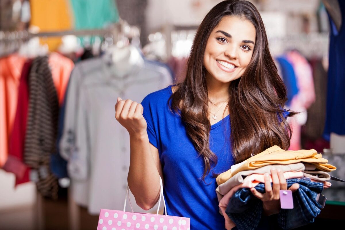 Happy woman shopping for clothes and smiling at the camera from the website of Priscilla Prentice